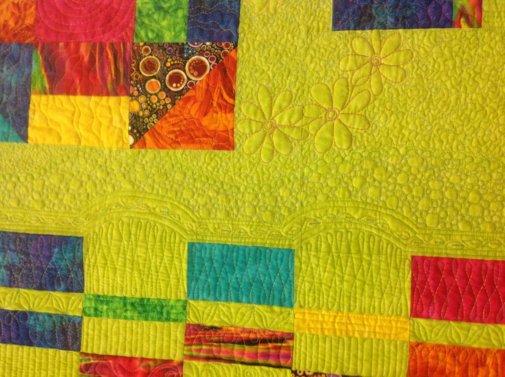 Joan Duffy told me to do what I wanted on her quilt, result, wrought iron fence, pebbled walkway and flowers everywhere!!